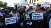 Demonstranten vragen om gerechtigheid Mitch Henriquez